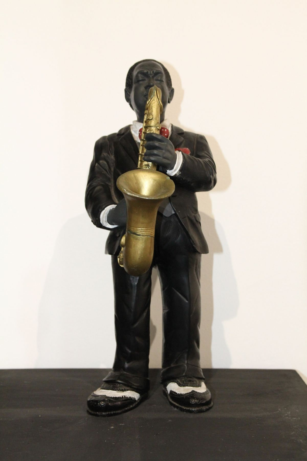 Statue en porcelaine Musicien époque XXème siècle